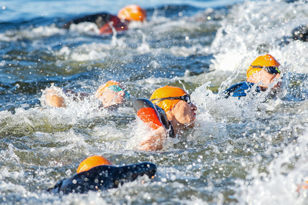 STOCKHOLM - AUG 23, 2015: Start of one of the mens groups swimming at ITU World Triathlon event in Stockholm. Editöryel