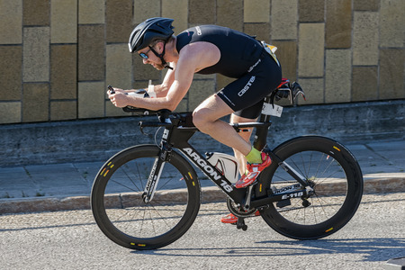 triathlete: STOCKHOLM - AUG 23, 2015: Triathlete cycling with a fast bike at the ITU World Triathlon event in Stockholm. Editorial
