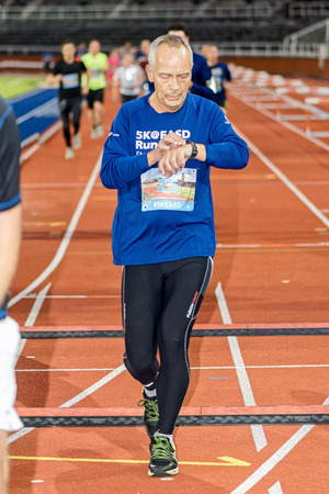 olympic stadium: STOCKHOLM - SEP 16, 2015: Man finish the event 5K EASD Run Walk to change diabetes at Stockholm Olympic Stadium with surroundings. 5000 meters for diabetes awareness. Editorial