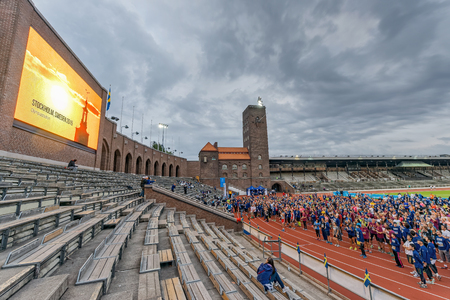 olympic stadium: STOCKHOLM - SEP 16, 2015: Warmup with aerobics before the race at the Stockholm Olympic Stadium for the event 5K EASD Run walk. 5000 meters for diabetes awareness.