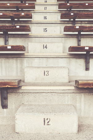 16 17: Stairs on the bleachers at a arena with numbers 12-18. Filters applied Stock Photo