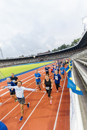 olympic stadium: STOCKHOLM - SEP 16, 2015: Happy runners just after the start at the Stockholm Olympic Stadium track in the event 5K EASD Run walk. 5000 meters for diabetes awareness.