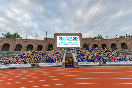 group photo: STOCKHOLM - SEP 16, 2015: Group photo of all participants before the race at the Stockholm Olympic Stadium for the event 5K EASD Run walk. 5000 meters for diabetes awareness.