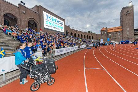 group photo: STOCKHOLM - SEP 16, 2015: Runners with strollers in the group photo of participants before the race at the Stockholm Olympic Stadium for the event 5K EASD Run walk. 5000 meters for diabetes awareness.