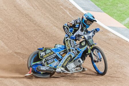 troy: STOCKHOLM - SEPT 25, 2015: Troy Batchelor from Australia in a curve at the TEGERA Stockholm FIM Speedway Grand Prix at Friends Arena in Stockholm. Editorial
