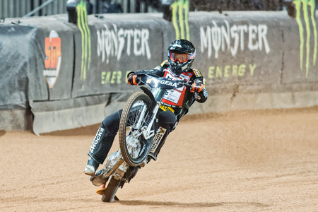 wheelie: STOCKHOLM - SEPT 25, 2015: Andreas Jonsson from Sweden doing a wheelie in a curve at the TEGERA Stockholm FIM Speedway Grand Prix at Friends Arena in Stockholm. Editorial