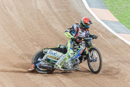 chris: STOCKHOLM - SEPT 25, 2015: Chris Holder from Australia in a curve at the TEGERA Stockholm FIM Speedway Grand Prix at Friends Arena in Stockholm.