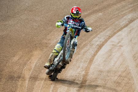 wheelie: STOCKHOLM - SEPT 26, 2015: Chris Holder from the USA celebrates the heat victory with a wheelie on the TEGERA Stockholm FIM Speedway Grand Prix at Friends Arena in Stockholm.