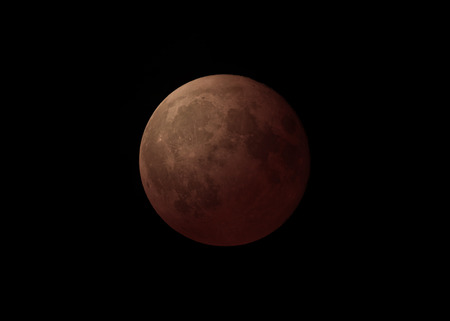 astrophoto: Detailed closeup of full blood moon with black sky during night, filters applied