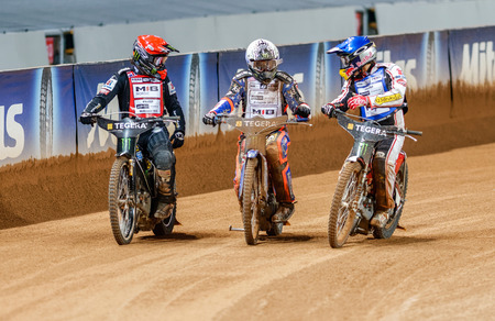 STOCKHOLM - SEPT 26, 2015: The winner of the GP Tai Woffinden with the other two finalists Hancock and Iversen after the final heat at the TEGERA Stockholm FIM Speedway Grand Prix at Friends Arena in Stockholm. Editorial