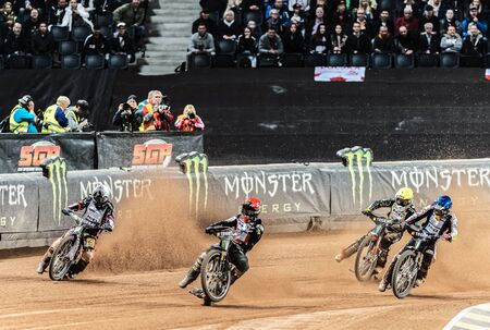 helmet seat: STOCKHOLM - SEPT 26, 2015: Action image of a group of speedway racers going into a curve at the TEGERA Stockholm FIM Speedway Grand Prix at Friends Arena in Stockholm.
