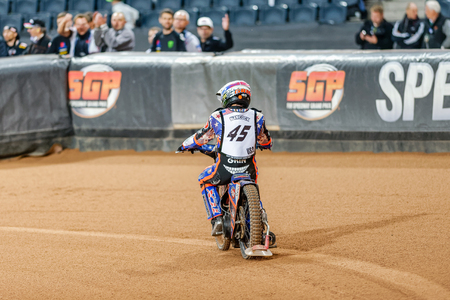 hancock: STOCKHOLM - SEPT 26, 2015: The back of Greg Hancock from the USA after the final heat at the TEGERA Stockholm FIM Speedway Grand Prix at Friends Arena in Stockholm.