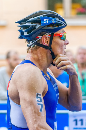 vasiliev: STOCKHOLM, SWEDEN - AUG 22, 2015: Ivan Vasiliev from Russia at the transition in the Mens ITU World Triathlon series event