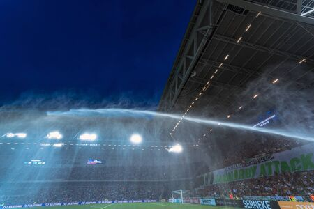 rivals: STOCKHOLM, SWEDEN - AUG 24, 2015: Tele2 Arena with water sprinklers before the derby soccer game between the rivals Hammarby and Djurgarden. Editorial