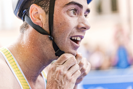 triathlon: STOCKHOLM, SWEDEN - AUG 22, 2015: Jacob Birtwhistle from Australia at the transition changing to cycling in the Mens ITU World Triathlon series event