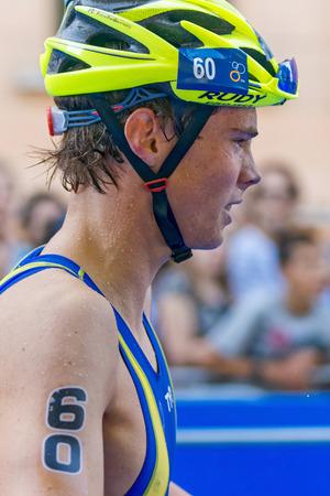 gabriel: STOCKHOLM, SWEDEN - AUG 22, 2015: Gabriel Sandor from Sweden at the transition in the Mens ITU World Triathlon series event