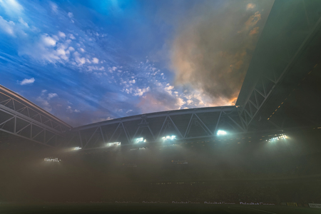 rivals: STOCKHOLM, SWEDEN - AUG 24, 2015: Tele2 Arena filled with smoke from the tifo before the derby soccer game between the rivals Hammarby and Djurgarden.