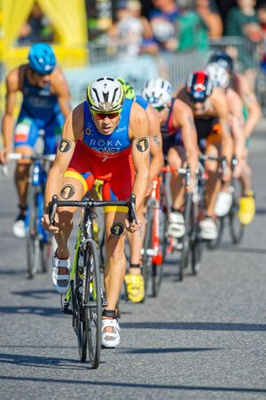 gomez: STOCKHOLM, SWEDEN - AUG 22, 2015: Overall leader Javier Gomez Noya in the lead on cycle at the Mens ITU World Triathlon series event