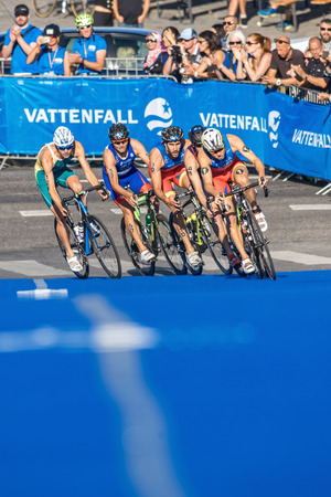gomez: STOCKHOLM, SWEDEN - AUG 22, 2015: Javier Gomez Noya from Portugal leading into a curve at the Mens ITU World Triathlon series event