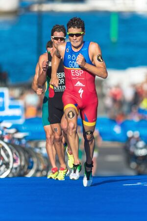 gomez: STOCKHOLM, SWEDEN - AUG 22, 2015: Javier Gomez Noya from Portugal leading at the running part at the Mens ITU World Triathlon series event