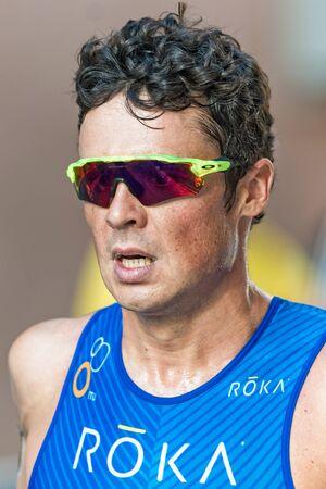 gomez: STOCKHOLM, SWEDEN - AUG 22, 2015: Closeup of leader Javier Gomez Noya from Portugal at the Mens ITU World Triathlon series event
