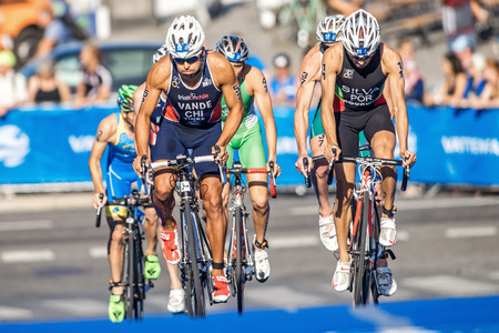 silva: STOCKHOLM, SWEDEN - AUG 22, 2015: Vande from Chile and Silva from Portugal cycling at the Mens ITU World Triathlon series event
