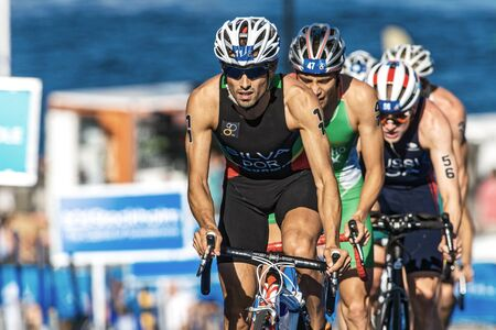 silva: STOCKHOLM, SWEDEN - AUG 22, 2015: Joao Silva from Portugal in front of a group of cyclists at the Mens ITU World Triathlon series event Editorial