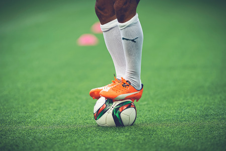 adidas: STOCKHOLM, SWEDEN - AUG 24, 2015: Closeup of soccer legs and feet in the game between Djurgarden and Hammarby at Tele2 arena.