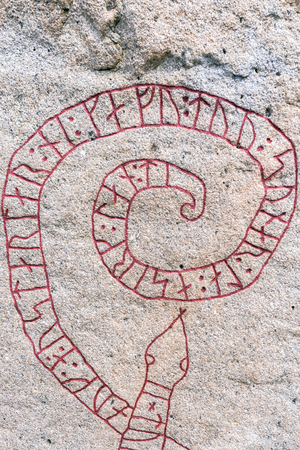 rune: MARIEFRED, SWEDEN - JULY 28, 2015: Detail of rune stone outside the Gripsholm castle in the idyllic small town of Mariefred at the shore of lake Malaren.