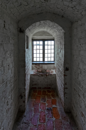 masonary: MARIEFRED, SWEDEN - JULY 28, 2015: Window through the thick wall at Gripsholm castle in the idyllic small town of Mariefred.