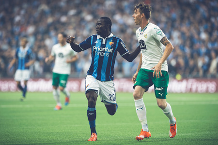 attacker: STOCKHOLM, SWEDEN - AUG 24, 2015: Attacker Sam Johnson (DIF) in the soccer game the rivals Djurgarden and Hammarby at Tele2 arena.
