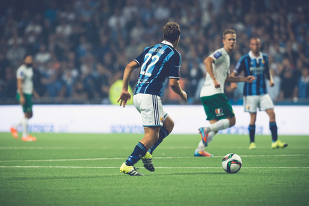 rivals: STOCKHOLM, SWEDEN - AUG 24, 2015: Jesper Karlstrom (DIF) playing at the soccer game between the rivals Djurgarden and Hammarby at Tele2 arena.
