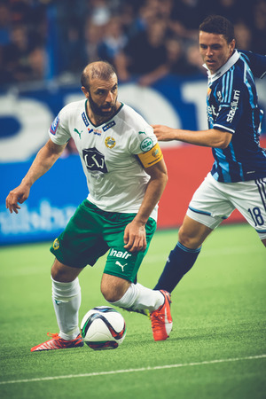 rivals: STOCKHOLM, SWEDEN - AUG 24, 2015: Midfielder Kennedy Bakircioglu and Kerim Mrabti at the soccer game of the rivals Djurgarden and Hammarby at Tele2 arena.
