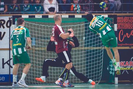 josef: STOCKHOLM, SWEDEN - NOV 4, 2015: Josef Pujol jump shooting at the Handball game between Hammarby vs Lugi at Eriksdalshallen. Allsvenskan Swedish leugue