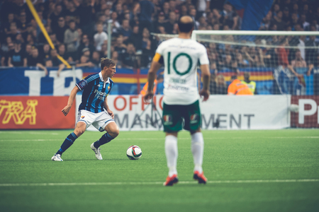 rivals: STOCKHOLM, SWEDEN - AUG 24, 2015: Midfielder Kennedy Bakircioglu at the soccer game of the rivals Djurgarden and Hammarby at Tele2 arena.
