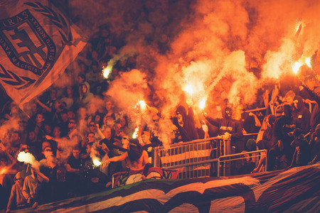 rivals: STOCKHOLM, SWEDEN - AUG 24, 2015: Hammarby fans and tifo at the soccer game between the rivals Djurgarden and Hammarby at Tele2 arena.