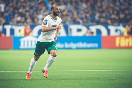 midfielder: STOCKHOLM, SWEDEN - AUG 24, 2015: Midfielder Kennedy Bakircioglu at the soccer game of the rivals Djurgarden and Hammarby at Tele2 arena.