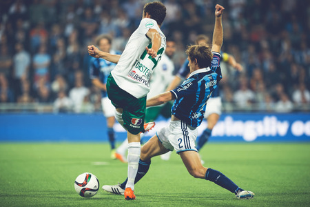 rivals: STOCKHOLM, SWEDEN - AUG 24, 2015: Soccer game between the rivals Djurgarden and Hammarby at Tele2 arena.