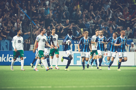 rivals: STOCKHOLM, SWEDEN - AUG 24, 2015: Djurgarden players after a goal at the soccer game between the rivals Djurgarden and Hammarby at Tele2 arena. Editorial