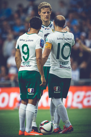 rivals: STOCKHOLM, SWEDEN - AUG 24, 2015: Kennedy Bakircioglu (HIF) talks with the players the soccer game the rivals Djurgarden and Hammarby at Tele2 arena. Editorial