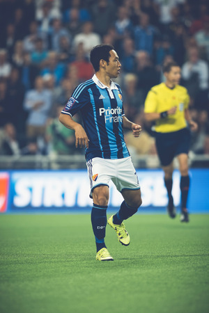 rivals: STOCKHOLM, SWEDEN - AUG 24, 2015: Soo Yong Yoon (DIF) at the soccer game the between rivals Djurgarden and Hammarby at Tele2 arena.