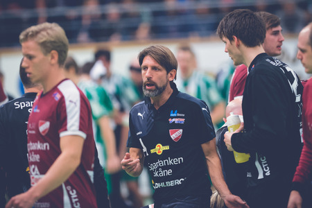 timeout: STOCKHOLM, SWEDEN - NOV 4, 2015: Trainer Tomas Axner after a timeout at the Handball game between Hammarby vs Lugi at Eriksdalshallen. Allsvenskan Swedish leugue