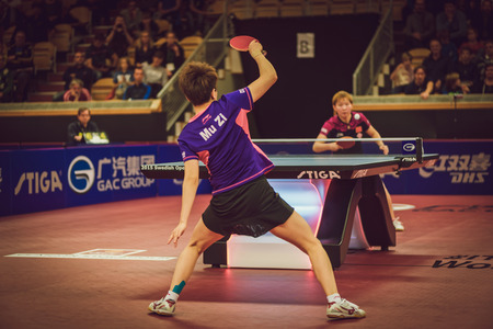 tabletennis: STOCKHOLM, SWEDEN - NOV 15, 2015: Finals between Mu Zi (CHI) and Zhu Yuling (CHI) in table tennis tournament SOC at the arena Eriksdalshallen.