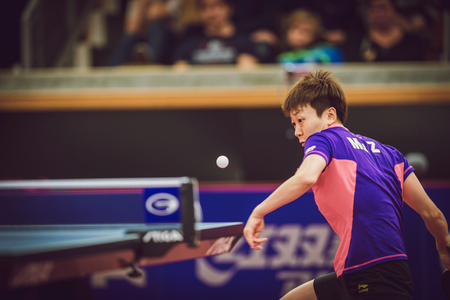 finals: STOCKHOLM, SWEDEN - NOV 15, 2015: Finals between Mu Zi (CHI) and Zhu Yuling (CHI) in table tennis tournament SOC at the arena Eriksdalshallen.