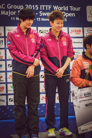 ye: STOCKHOLM, SWEDEN - NOV 15, 2015: Prize cermony for the women double in the table tennis tournament SOC at the arena Eriksdalshallen.
