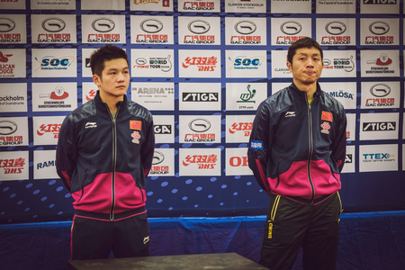 STOCKHOLM, SWEDEN - NOV 15, 2015: Finalists Fan Zhendong and Xu Xin from China in the table tennis tournament SOC at the arena Eriksdalshallen.