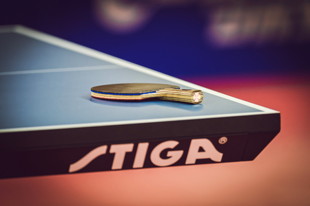 STOCKHOLM, SWEDEN - NOV 15, 2015: Rackets at table at the table tennis tournament SOC at the arena Eriksdalshallen. Editöryel