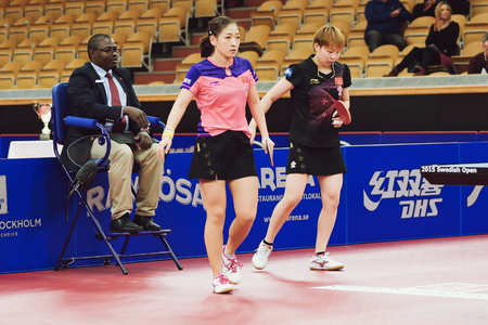 liu: STOCKHOLM, SWEDEN - NOV 15, 2015: Match between Zhu Yuling and Liu Shiwen from China at the table tennis tournament SOC at the arena Eriksdalshallen. Editorial