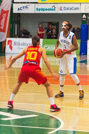 qualifier: SODERTALJE, SWEDEN - NOV 21, 2015: Fariha Abdi having the ball at the Women European Basketball Qualifier game between Sweden and Spain.