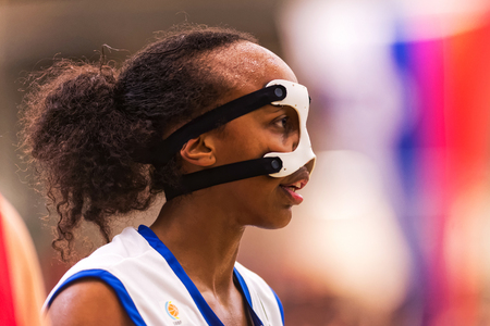 qualifier: SODERTALJE, SWEDEN - NOV 21, 2015: Abdi Farhaiya at the Women European Basketball Qualifier game between Sweden and Spain at Taljehallen.